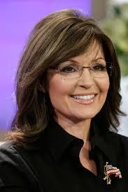 Sarah Palin is not a fan of Attorney General Eric Holder's idea for gun control bracelets or fingerprint identification on firearms. - elle-sarah-palin-de