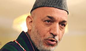 Hamid Karzai's decision to take control of Afghanistan's Electoral Complaints Commission is being seen as giving 'two fingers' to western sponsors. - Hamid-Karzai-addresses-a--001