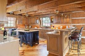 incredible log cabin lighting ideas using classic hanging lights above breakfast bar counter under marble countertops alongside wrought iron stools around cabin lighting ideas