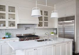 Amazing Kitchen Features Cream Cabinets Paired With White Marble Countertops And A Slab Backsplash