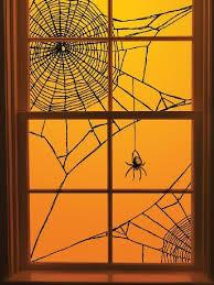 love halloween window decor: diy halloween spiderweb window decoration its just black yarn scotch tape