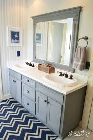 how to paint a small bathroom i like that this vanity looks like an old fashioned one because of the way they painted the frame and cabinets the same how to paint bathroom cabinets