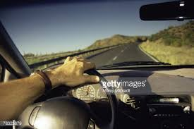 Image result for man  driving  long  road