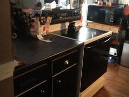 used black contact paper to cover ugly old cabinets black contact paper project