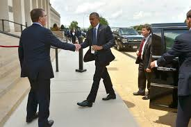 u s department of defense photo essay defense secretary ash carter greets president barack obama as he arrives at the pentagon
