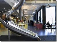 google victoria office. forget the conventional staircase google have installed a slide victoria office h