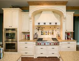 kelly home example of a classic kitchen design in dallas with raised panel cabinets beige cabinets cabinet lighting backsplash home
