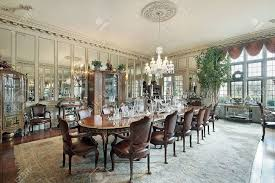 Wall Mirror For Dining Room Formal Dining Room In Traditional Home With Wall Mirrors Stock