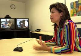 maria yap senior product manager for adobe systems inc discusses at her office in san jose calif the pros and cons of videoconferencing with michael adobe offices san jose san