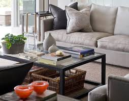 living room with simple lined beige sofa with charcoal and faded suzani style pillows black beige living room