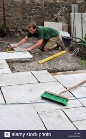 flagstone patio pavers size x artflyz patio  construction of a patio laying natural stone paving man measuri