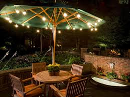 under an umbrella inexpensive party lights give patio backyard string lighting ideas