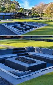 kitchen design entertaining includes: the design of this modern backyard includes a sunken firepit surrounded by seating to accommodate and entertain a large group of people