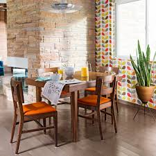 living room orla kiely multi: wallpaper by contemporary designer orla kiely creates a cheery background for a vintage dining table and