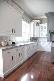 beautiful white kitchen cabinets: this is beautiful love the corner cabinet as well gray and white kitchen design