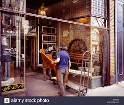 stock photo workers delivering furniture to post and beam reclamation antique home decor store at the junction neighbourhood in toronto antique home decoration furniture