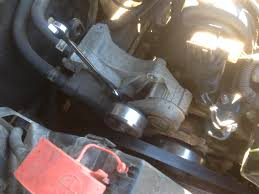 heater hose fitting replacement gm 3800 series v6 chickenroadlabs the alternator gone you can see the belt tensioner there are 4 bolts holding it one the wrench is on one and the other three are below the