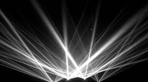 laser light beams projecting upward from the bottom center of the screen into the darkness above beams lighting