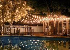 string lights over the pool make beautiful reflections shop the lengths you need at http beautiful lighting pool