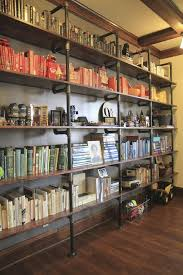 this looks so pretty all open shelving books things arranged by color i think this would be a great idea actually for garageworkshop shelving bookshelves office great