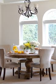 extending round table light and bright breakfast nook inspiration for a timeless dining room remodel breakfast table lighting