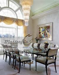 dining room modern tiered chandelier glass table modern sculpture on table ceiling dining room lights photo 2