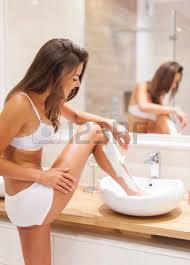 hygiene sink legs busy woman shaving legs in sink of bathroom stock photo picture and ro