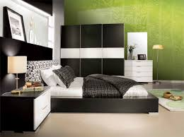 low profile black wooden bed plus black and white bedding set combined with large wardrobe and bedroom awesome black white bedrooms black
