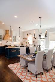 hand carved dining table timeless interior designer:  on a century old home for a newlywed couple who are undeterred by a challenging renovation for the interiors joanna strives for a timeless design
