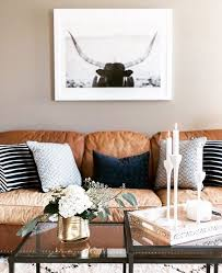 lauren_konrad paired a masculine leather couch with cozy patterned pillows from marshalls for a chic and inviting living room space chic living room leather