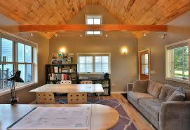 architects studio example of a transitional home studio design in other with medium tone hardwood floors wall and ceiling light ceiling lights for home office