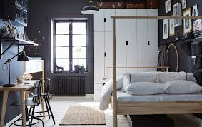 space living ideas ikea: a dark grey and white bedroom thats shared by a parent and child with an adults