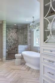 master bathroom with herringbone tile on floor freestanding tub and walk in shower artistic bathroom track lighting master bathroom ideas