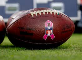nfl goes pink to support national breast cancer awareness month footballs pink breast cancer awareness logos sit on the turf prior to an nfl football game between the arizona cardinals and the st louis rams in