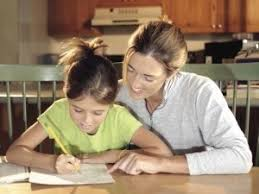 Image result for pic of parents looking at child doing homework