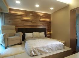 master bedroom feature wall:  bedroom x novel has a raised floor as a reading area and a wood paneled feature wall
