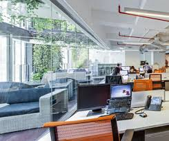 a collaboration hub has been positioned in the middle of the office serving as the companys nerve centre it contains a vc room a design centre buy matrix mid office