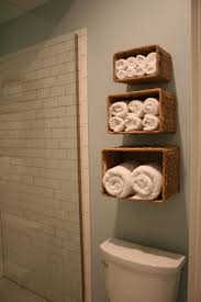 guest bathroom towels: towels in mounted baskets love this idea for our guest bathroom and
