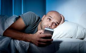 Image result for man with phone before sleep