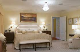 view in gallery relaxed bedroom ambiance in white and cream bedroom sconce lighting