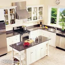 warm carpenter helper installing kitchen