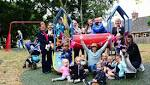 Children celebrate new equipment in their play area