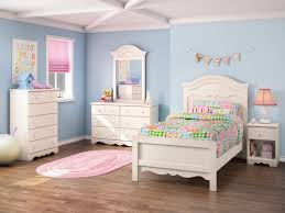 charming light blue wall paint theme teenage bedroom design featuring white finish wooden single beds plus blue kids furniture wall