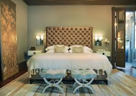 view full size master bedroom with upholstered walls bedroom sconce lighting
