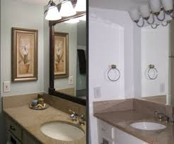 classic white vanity and brown granite top under bright classic bathroom lighting ideas bathroom lighting and mirrors