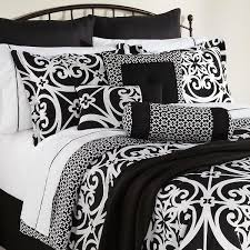 best black and white comforter applied on metal master bed which is installed in contemporary bedroom on dark flooring bedroom white bed set