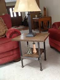 oak slab end table with black iron pipe legs black iron pipe table
