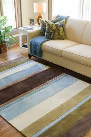 space living room olive: a visually appealing combination of brown and blue hues makes this retro striped rug a beautiful addition to your space this medium sized rug works well in