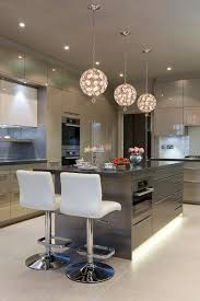 a kitchen for entertaining large contemporary u shaped kitchen idea in london with flat panel cabinets black modern kitchen pendant lights