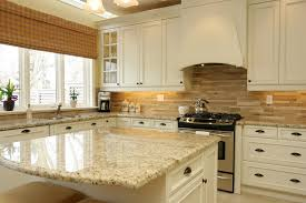 beautiful white kitchen cabinets: santa cecilia granite white cabinet backsplash ideas